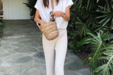 09 neutral striped pants, a white linen shirt, black slipper sandals and a little straw bucket bag
