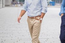 10 a blue striped shirt, tan chinos and white sneakers to create a comfortable casual look for work