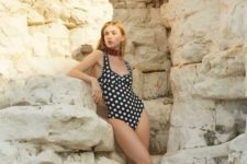 10 a chic black and white polka dot one piece swimsuit with a deep cut will be actual anytime