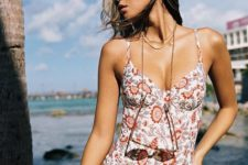 10 a floral one piece swimsuit with spaghetti straps, a high cut leg bottom for a retro feel