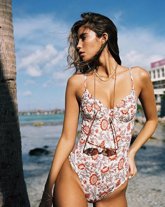 a floral one piece swimsuit with spaghetti straps, a high cut leg bottom for a retro feel