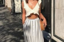 10 a neutral ruffle crop top, a striped midi skirt on buttons, a brown leather bag and sandals