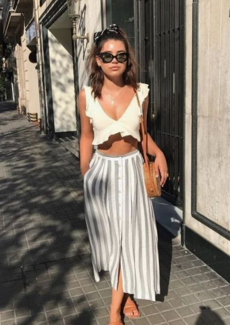 a neutral ruffle crop top, a striped midi skirt on buttons, a brown leather bag and sandals