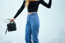 10 a party look with a black off the shoulder crop top, blue jeans, black strappy shoes and a black bag