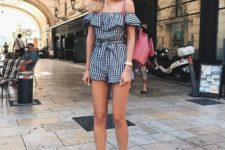 10 a plaid navy and white off the shoulder romper, white sneakers and a dusty pink bag