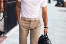 10 a white polo shirt, tan pants, white sneakers and a large handbag for a casual yet preppy look