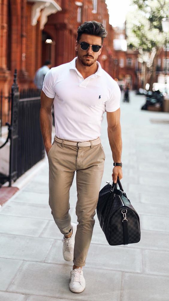 a white polo shirt, tan pants, white sneakers and a large handbag for a casual yet preppy look