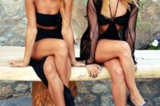 11 a black cutout one peice swimsuit with a black sheer coverup, denim espadrilles and a hat