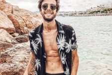 11 a black palm print shirt – a fresh take a classical bright piece, black trunks and sunglasses make up a monochromatic outfit