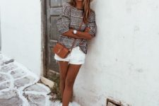 11 a printed top with short sleeves, white denim shorts with fringe, lace up sandals and a straw hat