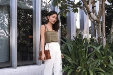 11 an olive green top on straps, white cropped pants, brown slipper sandals and a matching bag