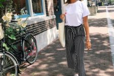 12 a comfy look with a white tee, black and white striped cropped pants, white sneakers and a tote