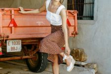 12 a feminine outfit with a white top with thick straps, a polka dot midi skirt and espadrilles