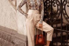 12 a snake print long sleeve top, high waisted creamy pants, sheer shoes and a brown leather bag