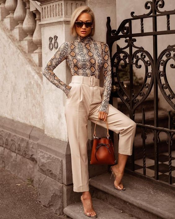 a snake print long sleeve top, high waisted creamy pants, sheer shoes and a brown leather bag