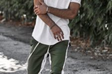 12 a sporty summer look with a white tee, a cap, green joggers and white sneakers