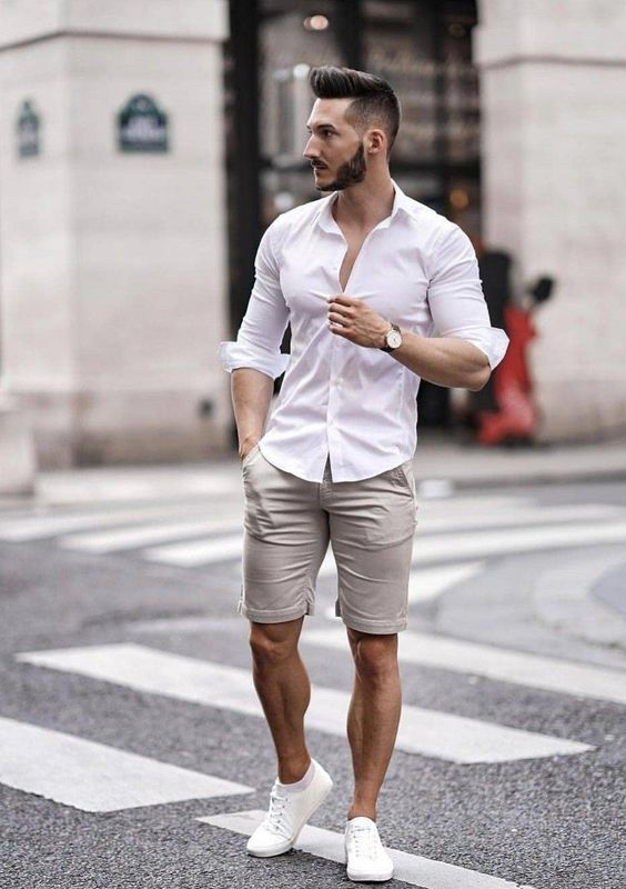 a stylish outfit with grey shorts, a white button up, white sneakers for a simple and comfy look