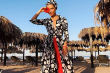 12 black and white printed maxi dress, bright red culottes, lac eup sandals and a striped headpiece