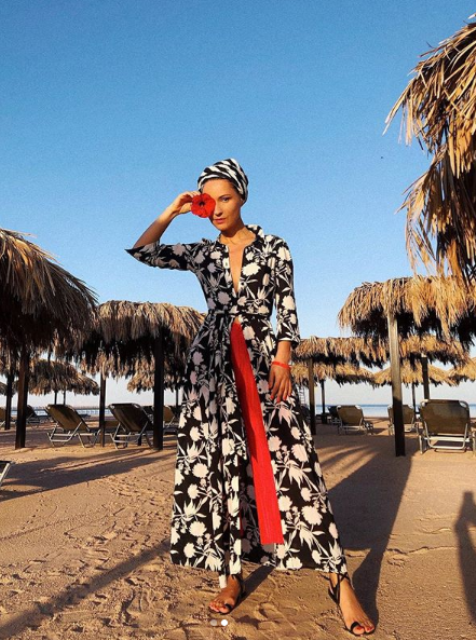black and white printed maxi dress, bright red culottes, lac eup sandals and a striped headpiece