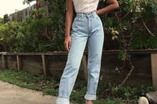 12 blue jeans, a white square neckline blouse, vintage-inspired shoes for a girlish feel