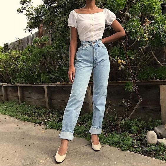 blue jeans, a white square neckline blouse, vintage-inspired shoes for a girlish feel