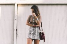 13 a camel top, a snake print mini skirt, lace up shoes and a brown saddle bag