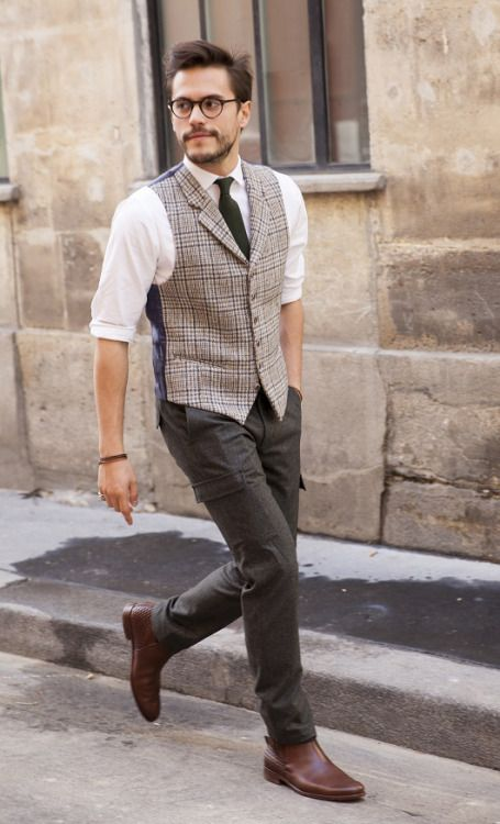 a casual work look with dark jeans, a plaid wiastcoat, a white shirt, a black tie and brown shoes