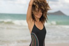 13 a chic black one piece swimsuit with colorful embroidery on the sides feel retro and boho