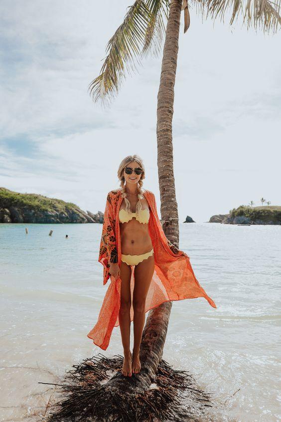 a scallop edge marigold bikini and an orange printed kimono for a colorful beach outfit