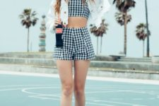 13 a sexy look with a plaid crop top and shorts, a white denim cropped jeacket, white sneakers
