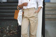 13 a white linen shirt, tn high waisted pants, espadrilles and an amber bucket bag