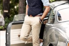 14 a casual yet chic work look with a plaid shirt, a navy waistcoat, tan pants, white sneakers and a plaid bow tie