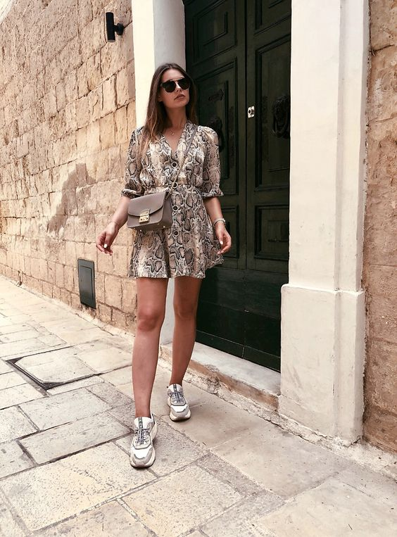 a snake print wrap mini dress, trainers, a brown crossbody bag for a casual and sexy look