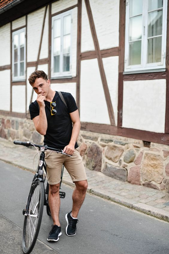 a sporty summer look with black sneakers, a black tee, tan shorts is ideal for many sports