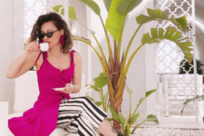 14 striped black and white culottes, a fuchsia over the knee dress, lace up sandals and a purple bag