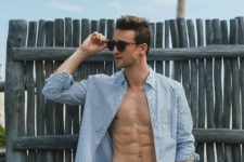 15 a striped blue and white shirt and printed navy trunks for comfortable beach time