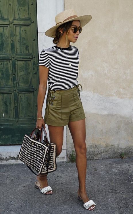 a striped tee, olive green shorts, embellished slippers, a printed bag and a straw hat for a sexy holiday look