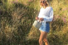 15 a white blouse, denim shorts with a stepped hem, white espadrilles and a small straw bag