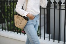 15 a white lace Victorian-style shir, bleached jeans, brown espadrilles, a straw bag with pompoms