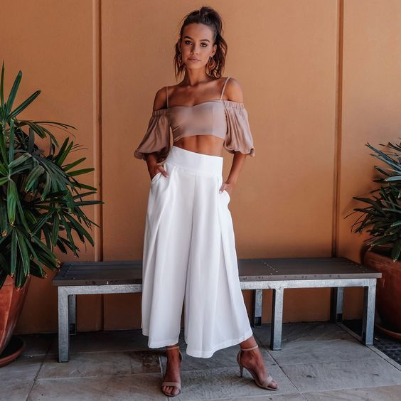 white high waisted culottes, a blush off the shoulder top with spaghetti straps, blush ankle strap shoes