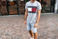 16 a printed grey tee, blue ripped denim shorts and white sneakers for a casual look