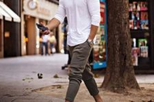 16 a white long sleeve tee, grey jogger pants and white sneakers for a comfy and sporty look