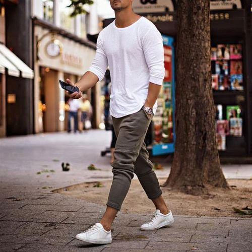 a white long sleeve tee, grey jogger pants and white sneakers for a comfy and sporty look