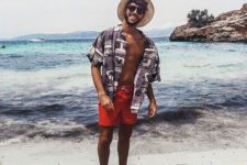 16 an oversized grey printed shirt, red trunks and a straw hat for a bold look with color and prints