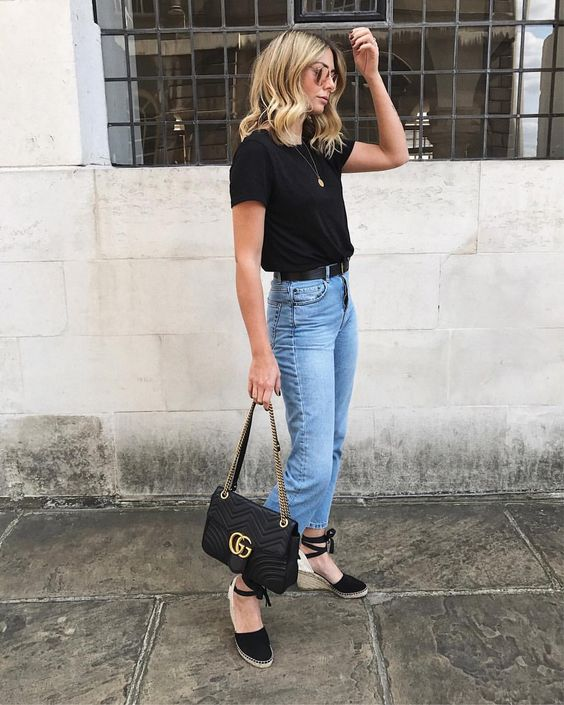 bleached jeans, a black tee, black espadrilles, a black bag for a casual summer look