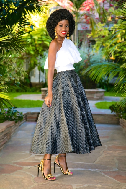 With A-line maxi skirt and black and golden high heels