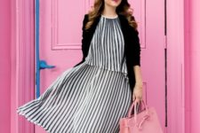 With black blazer, pale pink bag and black heeled shoes