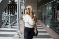 With black distressed jeans, black chain strap bag and printed sandals