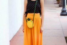 With black hat, orange skirt, orange flats and polka dot top