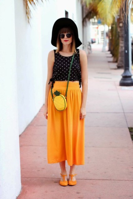 With black hat, orange skirt, orange flats and polka dot top